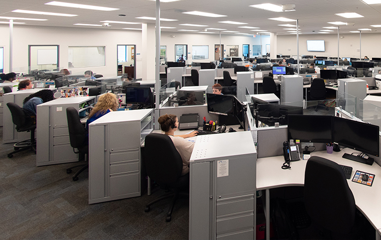 Office cubicles with busy workers.