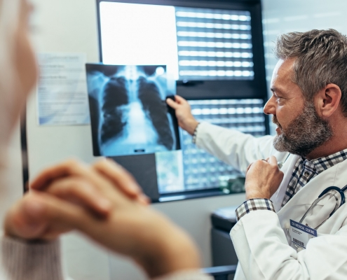Doctor with lung cancer patient
